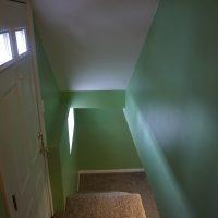 2111 Feldman Ave | basement stairway and side door entrance