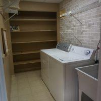 2111 Feldman Ave | 1st floor laundry room with washer, dryer, laundry tub and plenty of extra storage